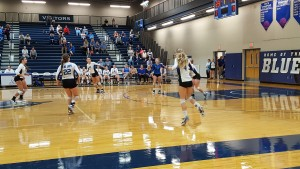 The Blue Jay Volleyball team playing at a home game pic